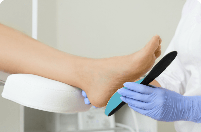 Orthotic being placed on patients foot